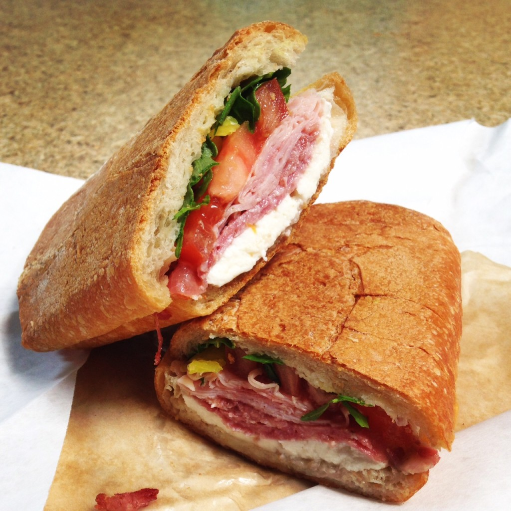 The Dude, from Each Peach Market Salami, ham, hot capicola, mozzarella, arugula, tomato, and banana peppers